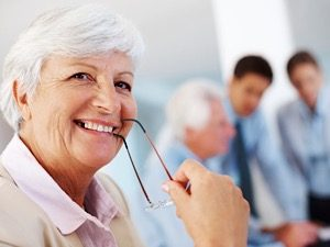 Mature woman smiling while running her business