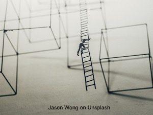 Figure climbing through an open grid structure